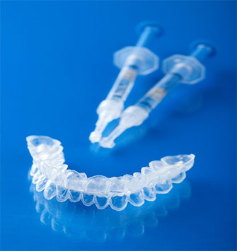 Whiten your teeth at home with take-home whitening trays, custom-made to fit your teeth precisely.