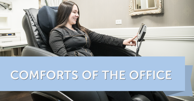 Woman in massage chair in dentist waiting office